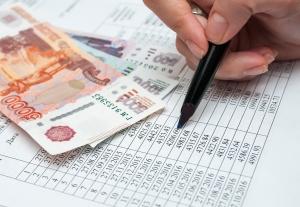 Что выгоднее при досрочном погашении кредита: сократить срок или платёж?